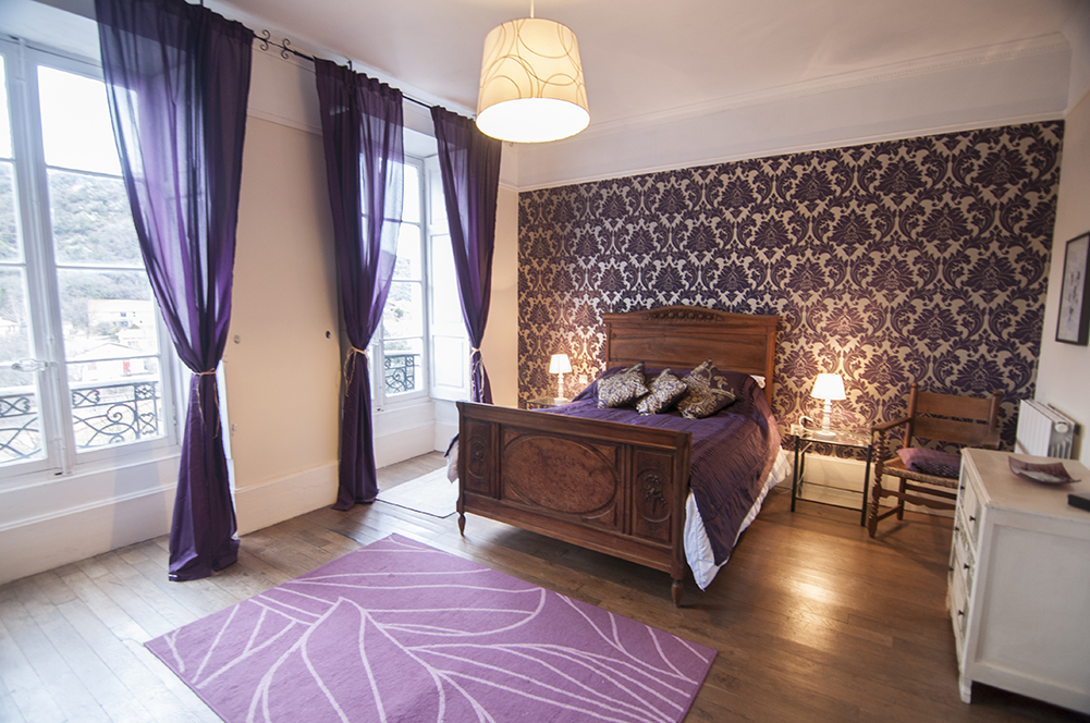 Purple apartment bedroom